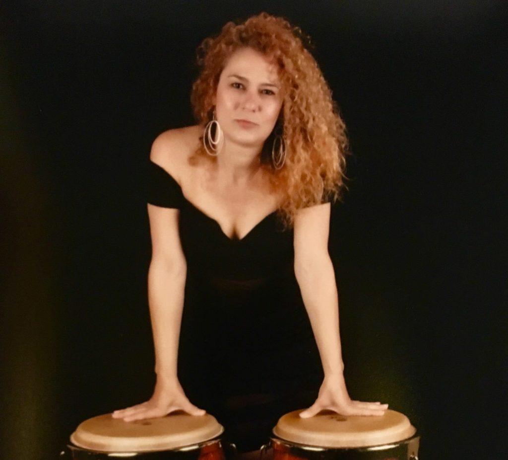 Yarelis Gandul standing with drums.